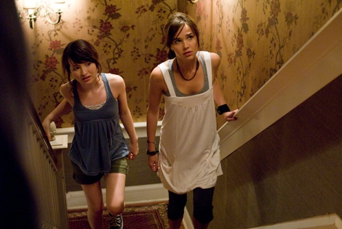 Anna (Emily Browning) and Alex (Arielle Kebbel) hear things go bump in the night