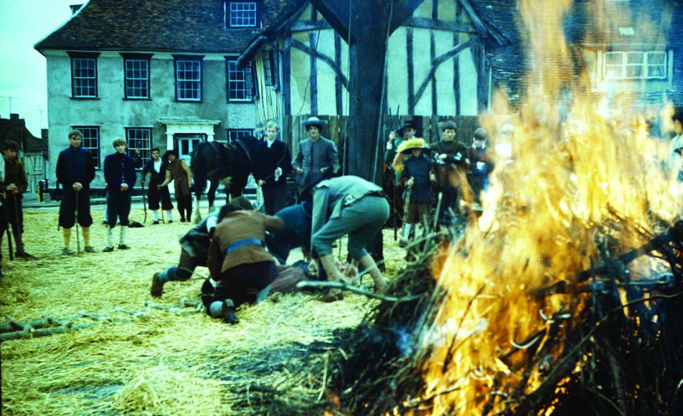 Prepping the fire for the execution of an alleged witch