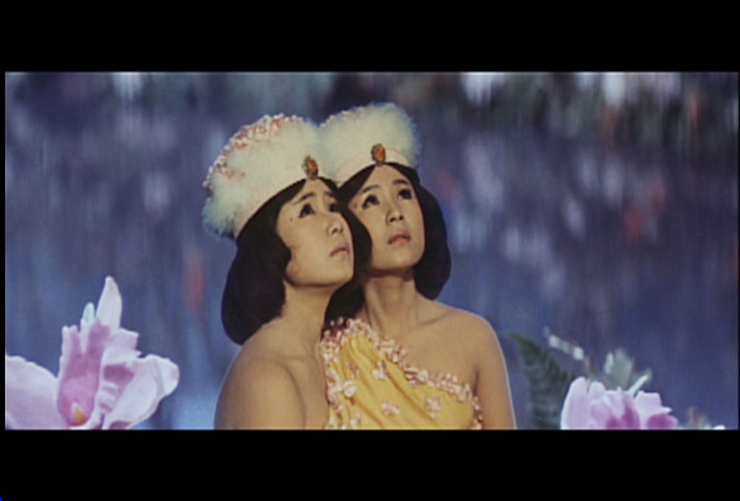 Singers Yumi and Emi Ito as Mothra's twin fairies.