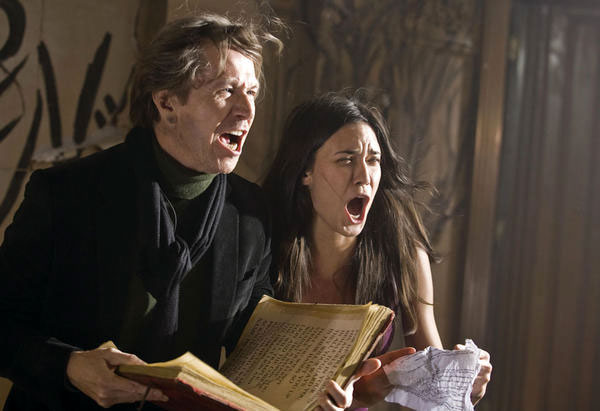 Gary Oldman and Odette Yustman