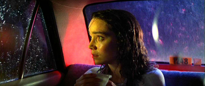 Suzy Banyon (Jessica Harper) take a taxi to the dance academy - an example of the film's artificial lighting schemes.
