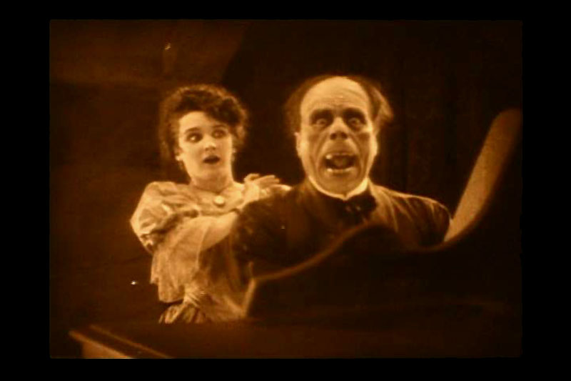 Christine (Mary Philbin) unmasks the Phantom (Lon Chaney)