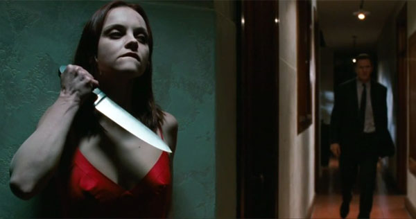 Miss Taylor (Christina Ricci) prepares to defend herself against the mortician (Liam Neeson), who insists that she is dead.