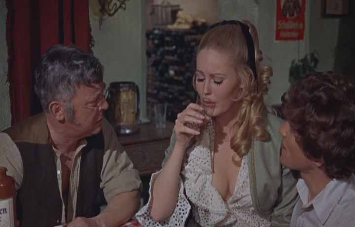 The innkeeper (Michae Ripper) and Paul (Barry Andrews) console Maria (Veronica Carlson) after a close encounter with Dracula.