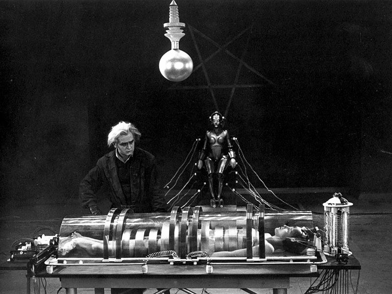 Mad scientist Rotwang (Rudolf Klein-Rogge) prepares to transform his robot into the likeness of Maria (Brigitte Helm)