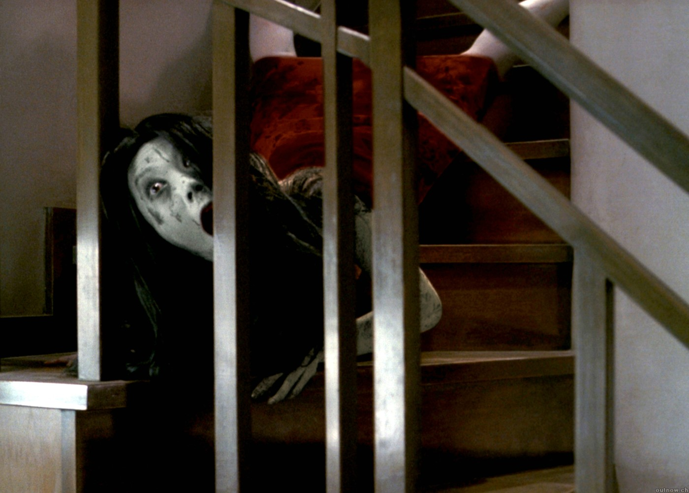 THE GRUDGE: Kayako (Takako Fuji) performs her infamous downstairs crawl in the American remake.