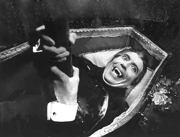 The vampire (Christopher Lee) is staked but manages to survive