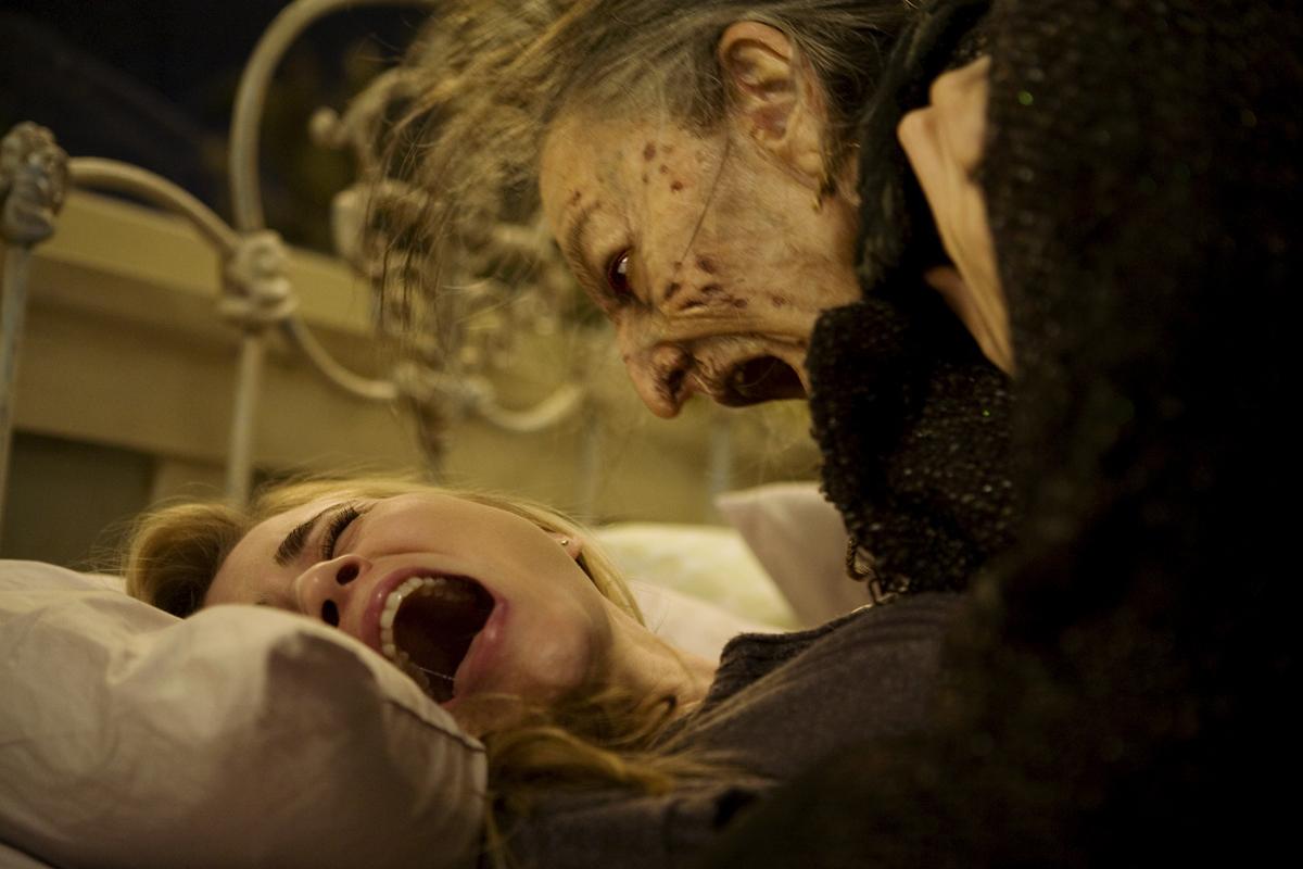 Christine (ALISON LOHMAN) is attacked by Mrs. Ganush (LORNA RAVER)