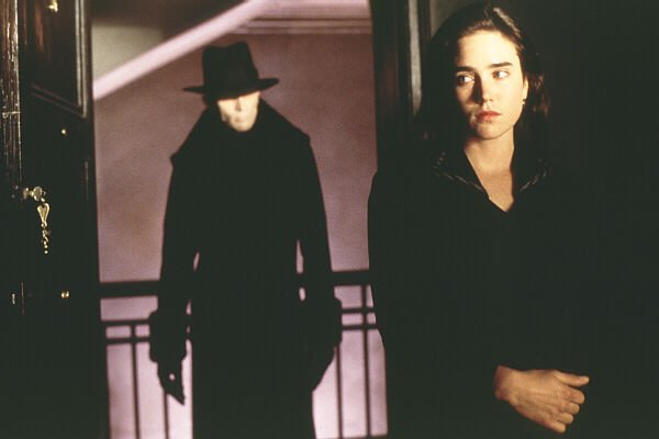 Murdoch's wife (Jennifer Connelly) is menaced by one of the mysterious Strangers (Richard O'Brien)