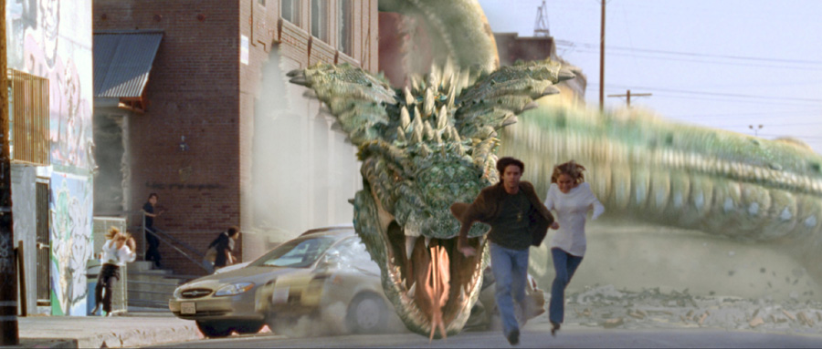 Jason Behr and Amanda Brooks flee the rampaging serpent