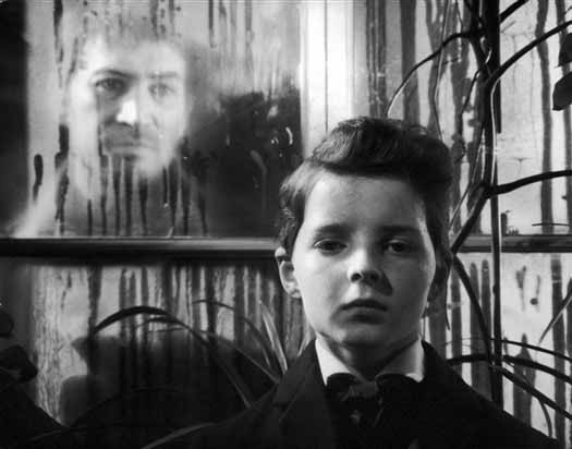 The ghost of Quint (Peter Wyngarde) oversees young Miles (Martin Stephens).