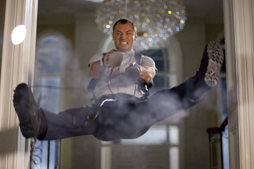 Remy (Jude Law) gets blasted by a faulty defribrilator.