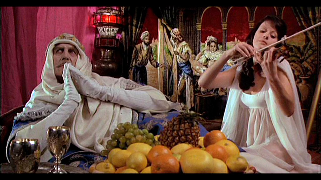 Phibes (Vincent Price) with the new Vulnavia (Valli Kemp)