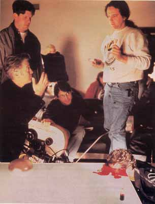 Director David Lynch (left bottom) sets up a shot of the absurdly grotesque death of Any (Micael Massee).