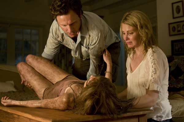 After being abused and shot, Mari (Sarah Paxton) is attended by her parents (Tony Goldwyn and Monica Potter).