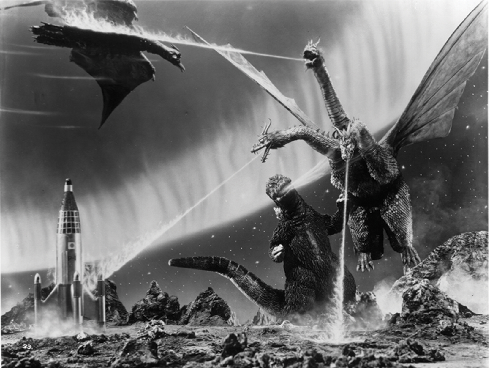 Godzilla and Rodan battle King Ghidorah on PLANET X