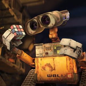 Wall-E examines a rubic's cube - an example of using pantomime to give personality to a non-speaking character.