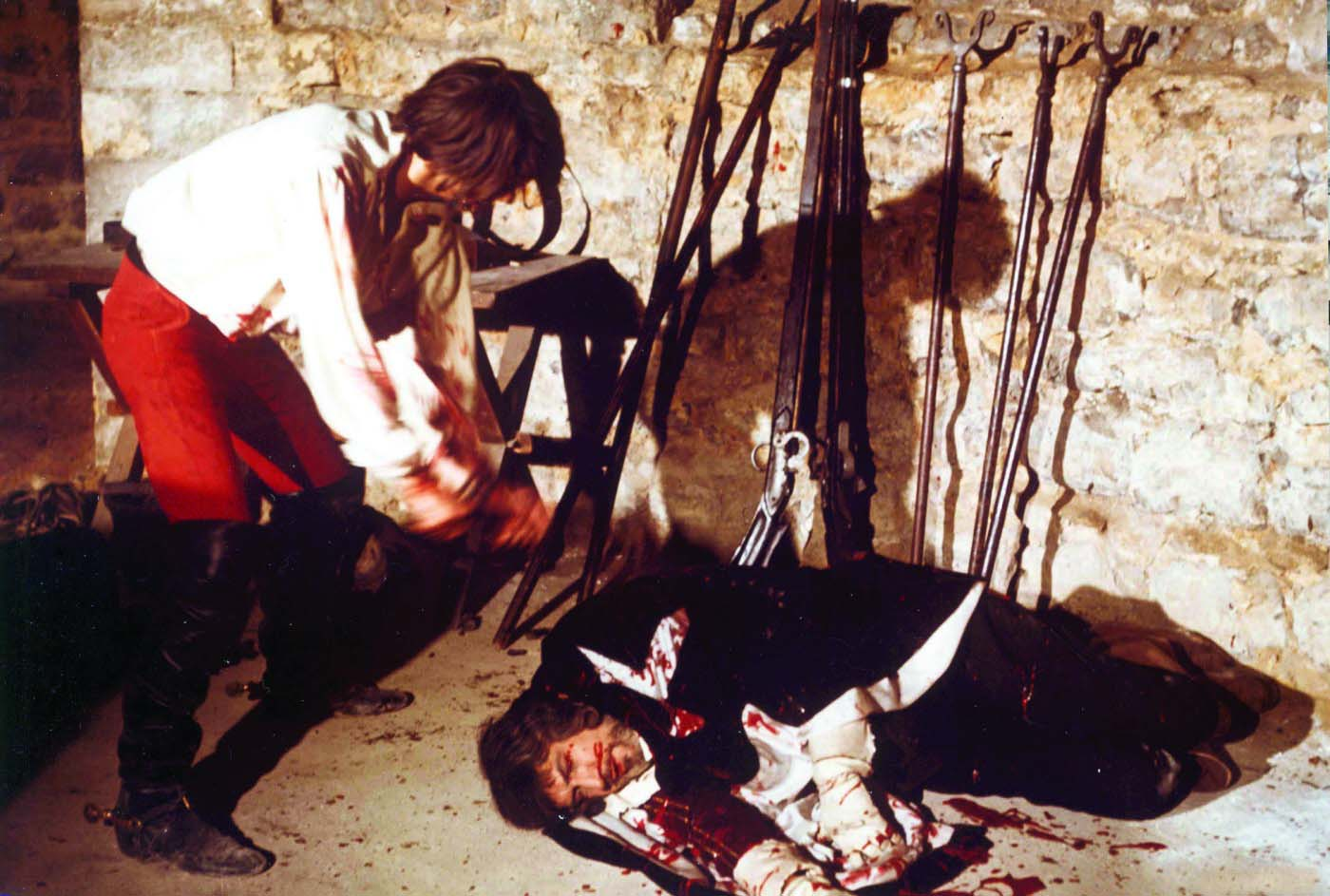 Ian Ogilvy stands over the bloody body of Vincent Price at the conclusion.