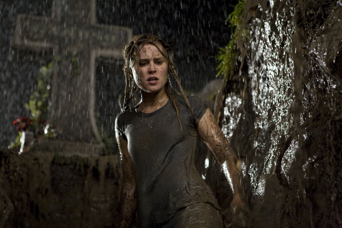 Christine (ALISON LOHMAN) descends into the muck in a vain attempt to save herself.