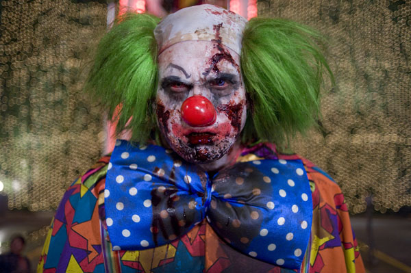 A clown zombie played by stuntman Derek Graf