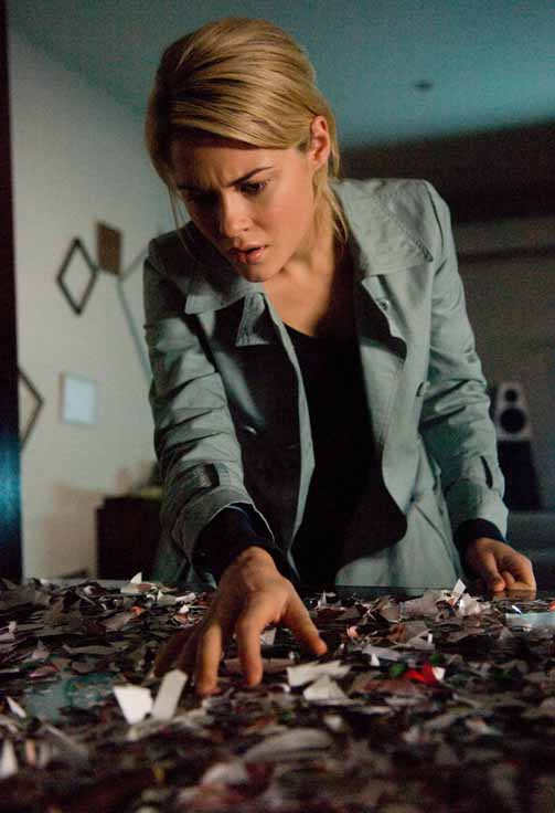 Jane (Rachel Taylor) discovers a clue to the haunting.