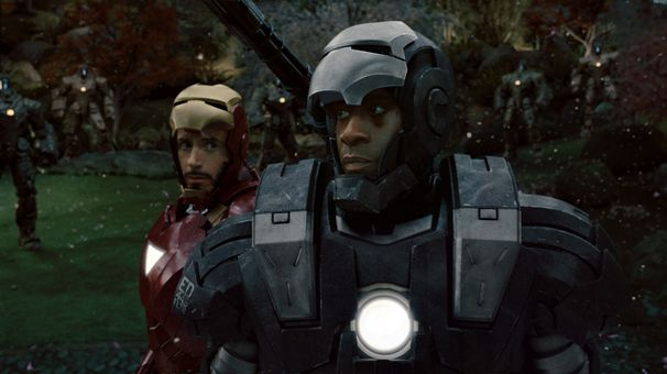 Stark (Robert Downey Jr) realizes he needs assistance from Rhodes (Don Cheadle)